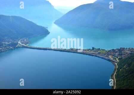 View of Lake Lugano panorama from Monte San Salvatore Bridge over Lake Lugano in Switzerland. - Stock Photo