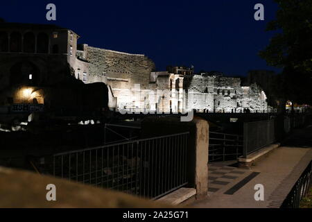 View of the Roman Forum at night. The Roman Forum, also known by its Latin name Forum Romanum, is a rectangular forum surrounded by the ruins of several important ancient government buildings at the centre of the city of Rome. - Stock Photo