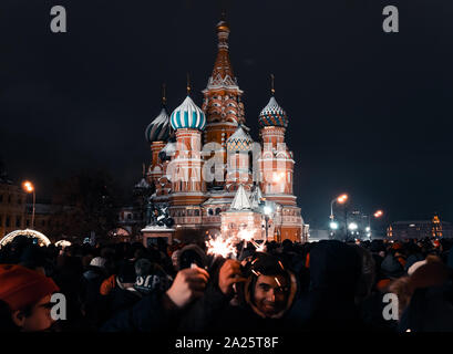 Moscow, Russia -January 1, 2019: Many people gathered for a universal celebration New Year's in Moscow on Red Square near the St. Basil's Cathedral - Stock Photo