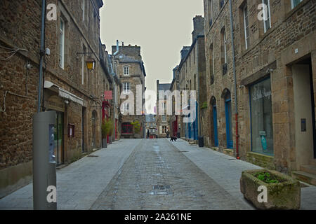 DINAN, FRANCE - April 7th 2019 - Empty street with stone building in traditional town