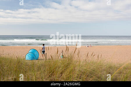 Rodiles Beach has an approximate length of 1,000 m. It is a beach of fine and toasted sand. Suitable for the practice of several sports, mainly surfin - Stock Photo