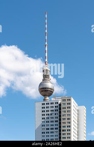 Cityscape of Berlin with skyscraper and TV tower against blue sky with clouds - Stock Photo