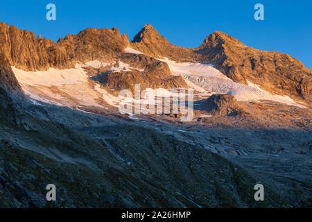 Reichenspitzgruppe. Reichenspitze peak. Sunrise sunlight on peaks and glaciers. Zillertal Alps. Hohe Tauern National Park. Austrian Alps. - Stock Photo