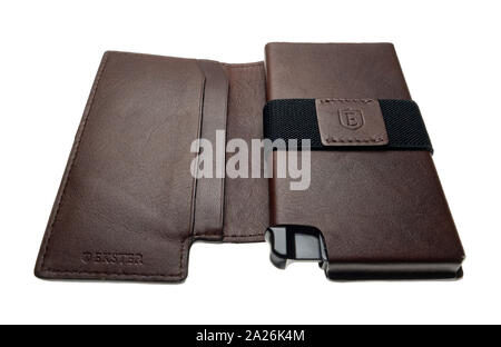 An Ekster smart wallet gives quick access to credit or debit cards. Offers RFID protection. - Stock Photo