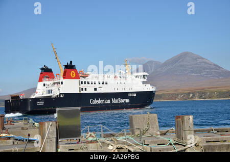 MV Finlaggan, Caledonian MacBrayne island ferry at Port Askaig on the Scottish Island of Islay. The Paps of Jura hills can be seen in the background. - Stock Photo