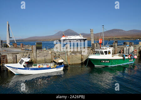 MV Finlaggan, a Caledonian MacBrayne island ferry at Port Askaig on the Scottish Island of Islay. The Paps of Jura can be seen in the background. - Stock Photo