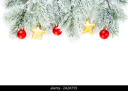 Christmas border composition with red glass baubles, gold stars, holly berries and green fir branch isolated on white background. Xmas flat lay top vi - Stock Photo