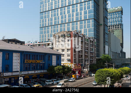 04.02.2017, Yangon, , Myanmar - A modern high-rise office building and a luxury hotel flank the Junction City shopping centre in the city centre of th - Stock Photo