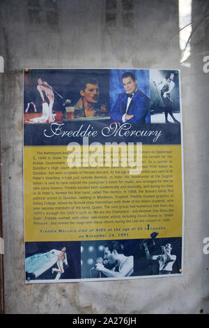 Historical and bibliographical poster of Freddie Mercury encased in glass inside the Mercury House Museum, Stone Town, Zaqnzibar, Unguja Island, Tanzania. - Stock Photo