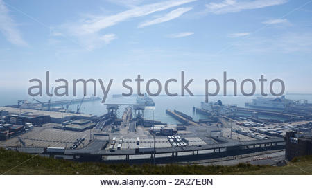 Hazy view from the cliff top as a DFDS ferry leaves the Port of Dover: Kent. - Stock Photo