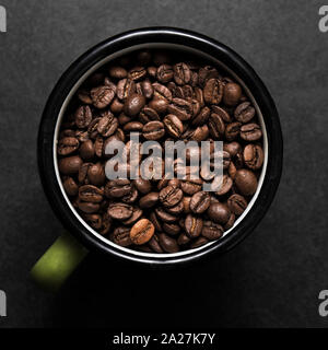Fresh roasted coffee beans in metal coffee cup - Stock Photo
