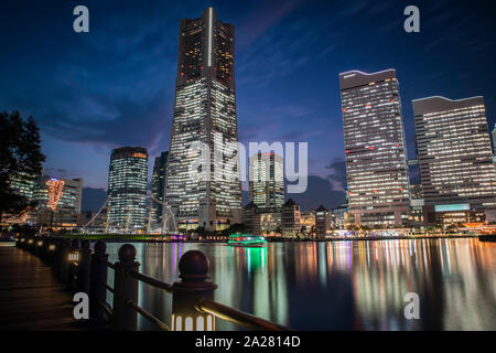 Minato Mirai, Yokohama - September 30, 2019 : View of the Landmark Tower during sunset. Landscape orientation. - Stock Photo