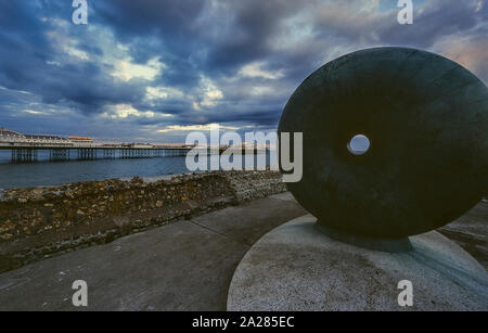 Palace Pier and the bronze statue Afloat, Brighton, East Sussex, England, UK. Circa 1980's