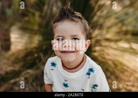 Close up portrait of cute young toddler boy smiling