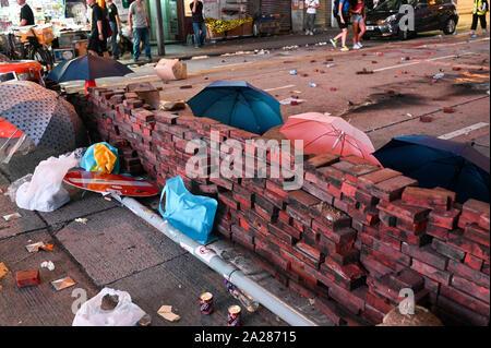 Hong Kong, Hong Kong Sar. 01st Oct, 2019. A barricade of bricks and umbrellas is left behind by protesters in Hong Kong on October 1, 2019. Photo by Thomas Maresca/UPI Credit: UPI/Alamy Live News - Stock Photo