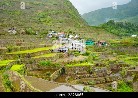 Batad village in early spring rice planting season, Banaue, Mountain Province, Cordillera Administrative Region, Philippines - Stock Photo
