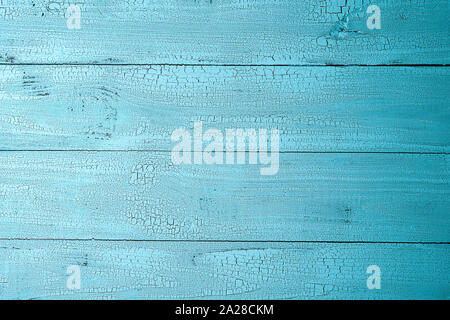 Highly detailed natural old wooden planks painted in blue color with cracks. Textured background with horizontal layout and copy space. View from abov - Stock Photo