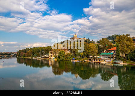 Italy Piedmont Turin Valentino park - View with river Po and Monte dei Cappuccini ( Santa Maria del Monte Church ) - Stock Photo