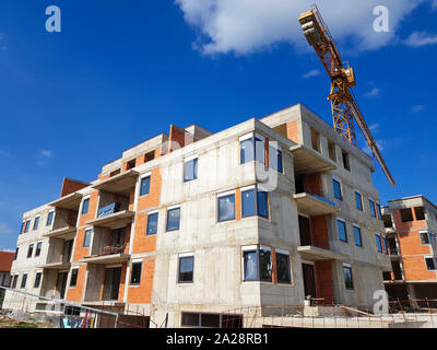 Construction of the building. A crane can be seen in the background. downwards. Constraction yard. - Stock Photo