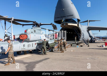 OSTRAVA, CZECH REPUBLIC - SEPTEMBER 22, 2019: NATO Days. An AH-1Z Viper helicopter of the US Marines HMLAT-303 squadron is being loaded into C-5M Supe Stock Photo