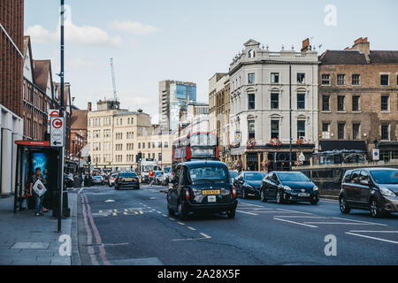 London, UK - September 07, 2019: Bus 24 towards Aldgate and cars on a street in Tower Hamlets, a borough located in East London and covers much of the - Stock Photo