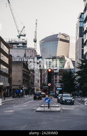 London, UK - September 8, 2019: Cars on a road in Aldgate, London, 20 Fenchurch Street, known as a Walkie Talkie building and a home of Sky Garden, on - Stock Photo