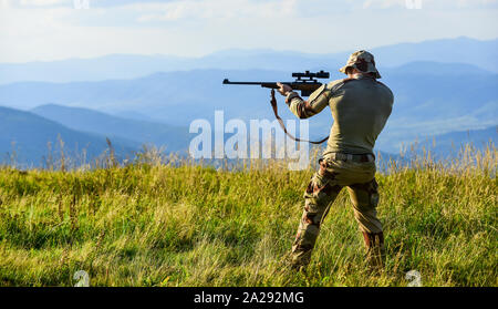 Military Operation in Action. hunter in camouflage. security of democracy. defender of motherland. man with gun. military fashion. war time. soldier in service. weapon shop concept. weapon permit. - Stock Photo