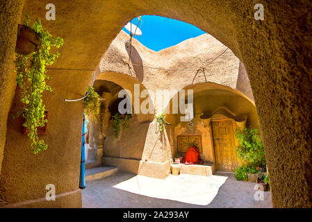 Courtyard of berber underground dwellings. Troglodyte house. Matmata, Tunisia, North Africa - Stock Photo
