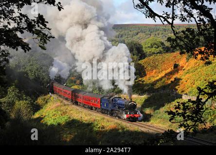 6023 King Edward II heads past Thomason Foss on the NYMR during the autumn steam gala. - Stock Photo