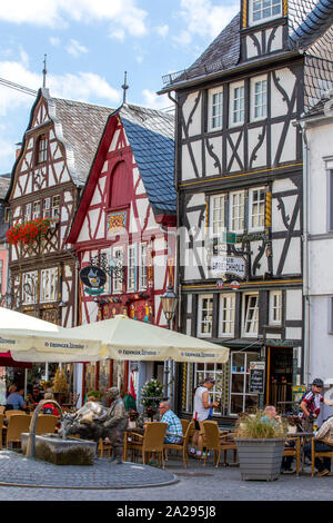 Old town of Rhens, in the Rheingau, in the UNESCO World Heritage Upper Middle Rhine Valley, gastronomy in old half-timbered houses, Germany - Stock Photo