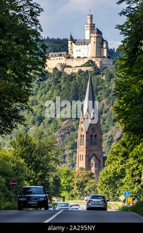 Marksburg Castle, near Braubach, in the Rheingau, in the UNESCO World Heritage Upper Middle Rhine Valley, St. Lambertus Church in SpayGermany - Stock Photo