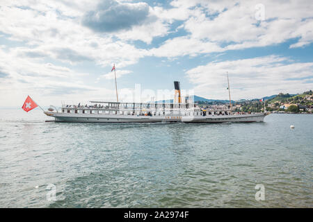 The most beautiful flagship Belle Epoque steam boat called La Suisse approaching Montreux pier on Swiss Riviera, Vaud, Switzerland - Stock Photo