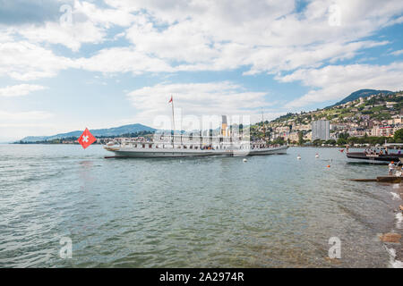 The most beautiful  steam boat called La Suisse approaching Montreux pier on Swiss Riviera, Vaud, Switzerland on summer day - Stock Photo