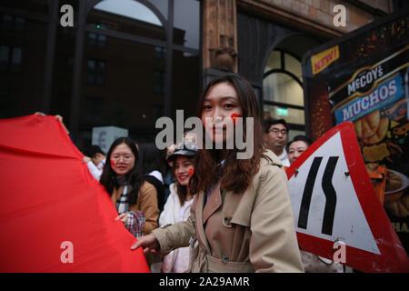 Manchester, UK. 1st October, 2019. Chinese peoples celebrate the National Day of the people's republic of China with a counter protest calling for freedom for Hong kong,   Manchester, Lancashire, UK. Credit: Barbara Cook/Alamy Live News - Stock Photo