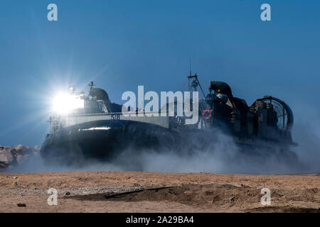 190909-N-NB544-1603 AQABA, Jordan (Sep. 9, 2019) Landing Craft, Air Cushion (LCAC) 58, attached to Assault Craft Unit 5, lands on the beach during LCAC operations. USS John P. Murtha (LDP 26) is part of the Boxer Amphibious Ready Group and 11th Marine Expeditionary Unit and is deployed to the U.S. 5th Fleet area of operations in support of naval operations to ensure maritime stability and security in the Central Region, connecting the Mediterranean and the Pacific through the Western Indian Ocean and three strategic choke points. (U.S. Navy photo by Mass Communication Specialist 2nd Class Kyle - Stock Photo