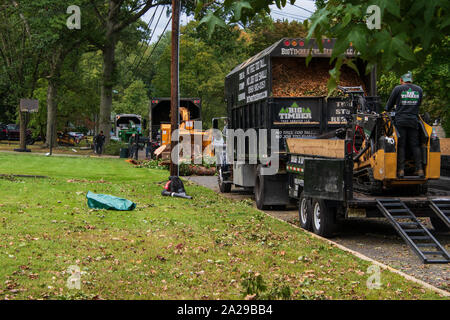 Cherry Hill, New Jersey - September 30, 2019: Tress service trucks line the streets removing fallen trees after a severe wind storm passed through thi - Stock Photo