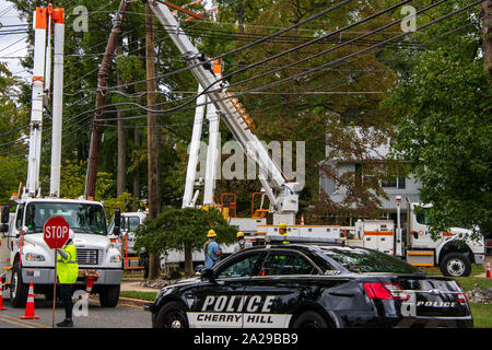 Cherry Hill, New Jersey - September 30, 2019: Utility crews were repairing fallen electric wires and poles after a strong storm caused extensive damag - Stock Photo