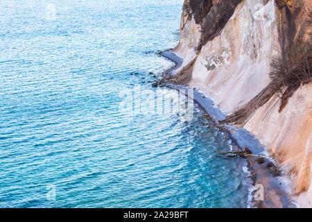 Huge eroded chalk cliffs at stony coast of Ruegen island, Germany (copy space) - Stock Photo