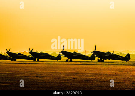 Spitfires at Dawn - 75th Anniversary of the Battle of Britain, Duxford, UK. - Stock Photo