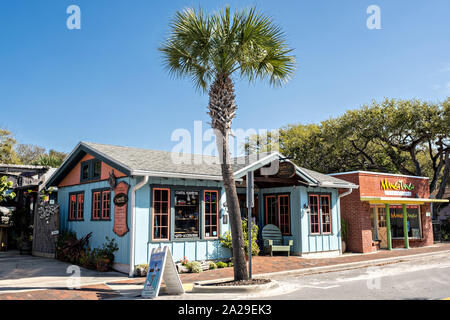 Eclectic boutiques along the historic Flagler Avenue shopping district in New Smyrna Beach, Florida. - Stock Photo