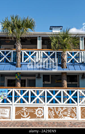 Eclectic boutiques and restaurants along the historic Flagler Avenue shopping district in New Smyrna Beach, Florida. - Stock Photo