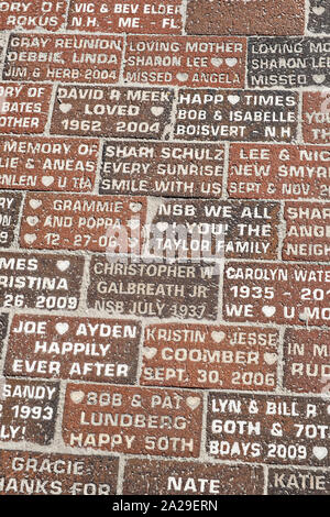 Bricks engraved with messages along the historic Flagler Avenue shopping district in New Smyrna Beach, Florida. - Stock Photo
