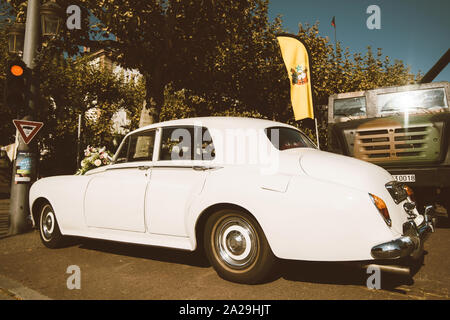 Strasbourg, France - Sep 21, 2019: Side view of white luxury wedding limousine Rolls-Royce car parked on French street - Stock Photo