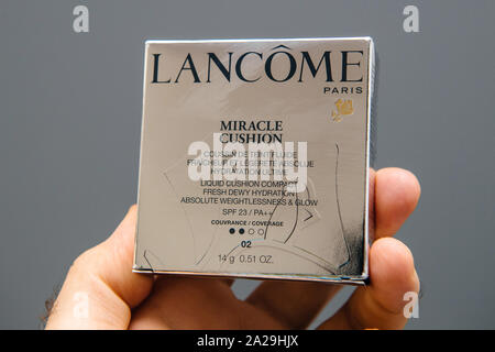 Paris, France - Spe 13, 2019: POV man hand new Lancome Miracle Cushion the modern liquid cushion compact with SPF 23 - Stock Photo