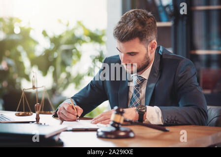 Lawyer or attorney working in the office. Law and justice concept