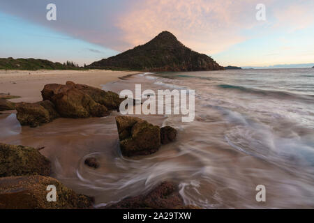 Mt Tomaree from Zenith Beach at sunrise, Port Stephens, New South Wales, Australia - Stock Photo