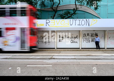 October 2 2019.  Hong Kong resumes business the morning after violent protests on October 1 2019.  Protest graffiti is found on Hong Kong Island after the National Day protests. - Stock Photo