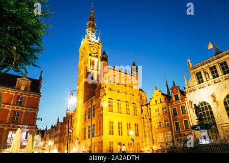 Town Hall and Neptune's Fountain at Dlugi Targ (Long Market) street at night in Gdansk, Poland - Stock Photo