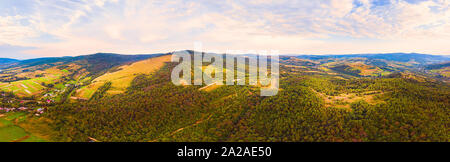 180 degrees panoramic landscape of countryside, aerial drone view of nature in Carpathians. Sunset time, end of summer. - Stock Photo