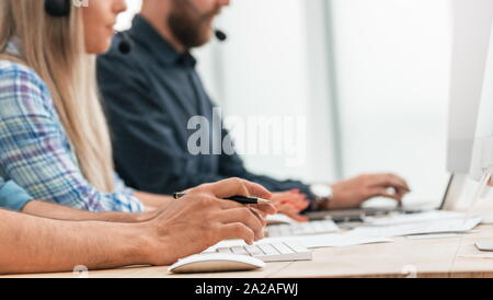 close up. call center operators in the workplace. - Stock Photo
